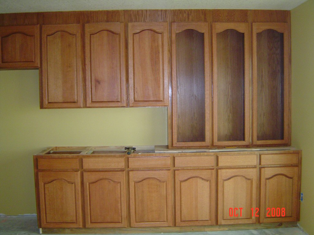 Red Kitchen with Oak Cabinets